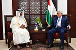 Palestinian President Mahmoud Abbas meets with a head of Qatar Football Federation at his headquarters in the West Bank city of Ramallah on March 11, 2018. Photo by Osama Falah
