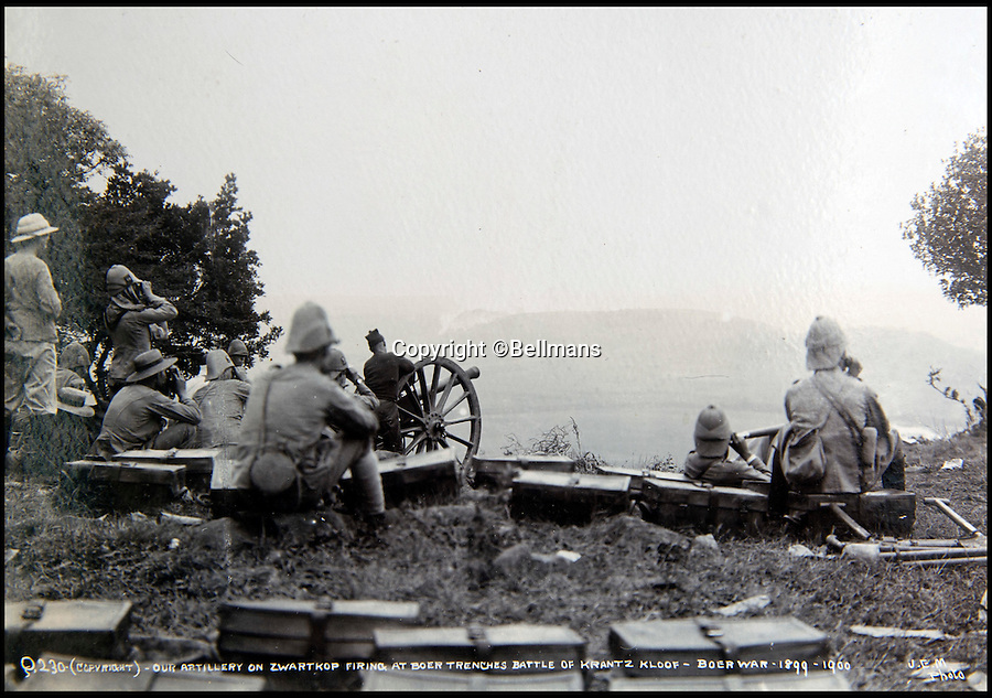 BNPS.co.uk (01202 558833)<br /> Pic: Bellmans/BNPS<br /> <br /> Artillery on Zwartkop firing at Boer trenches during the Battle of Krantzkloof, Boer War.<br /> <br /> A rare and extraordinary photo album documenting a British army regiment before, during and after the Boer War has been discovered after more than 100 years.<br /> <br /> The album contains more than 150 black and white images of the First Battalion, Rifle Brigade and provide a fascinating record of their battles with the Boers in South Africa from 1899 to 1902.<br /> <br /> The annotated images show a large parade of men before embarking on a ship on the Isle of Wight to take them to South Africa in 1899 followed by famous battles they were involved in when they got there.<br /> <br /> The action highlighted took place at Ladysmith, Spion Kop and St. Pieters.