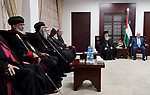 Palestinian President Mahmoud Abbas meets with a delegation of Churches at his headquarters in the West Bank city of Ramallah on December 18, 2017. Photo by Osama Falah