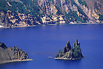 Tourist boat circles the Phantom Ship in Crater Lake, Crater Lake National Park, Oregon