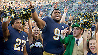 Jerry Tillery (99) and the Notre Dame Leprechaun celebrate after Notre Dame defeated the Nevada Wolf Pack 39-10 at Notre Dame Stadium.
