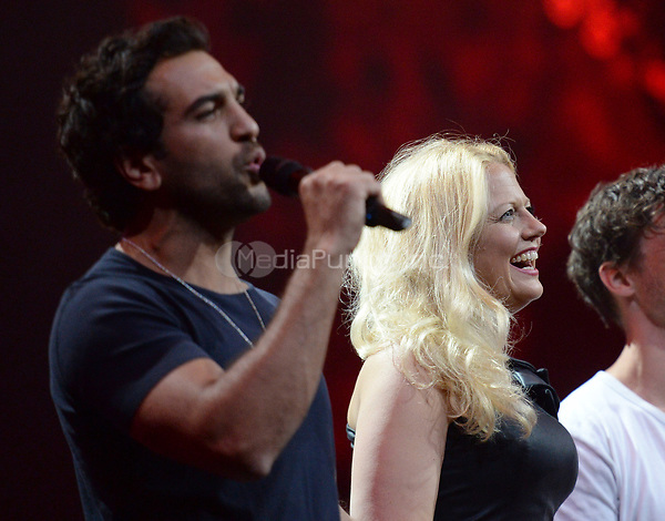 Actor Elyas M'Barek and moderator Barbara Schoneberger pictured on the stage during the first Global Citizen Festival Concert in Hamburg, Germany, 06 July 2017. The G20 Summit of the heads of government and state takes place on 7 and 8 July 2017 in Hamburg. Photo: Daniel Reinhardt/dpa /MediaPunch ***FOR USA ONLY***