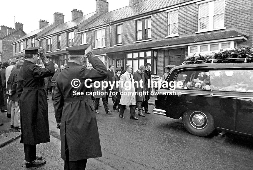 Funeral of 17 months old Colin Nicholl, the adopted son of Anne and &amp; Jackie Nicholl of Elimgrove Street, Belfast, N Ireland, UK. Colin was one of two children who died in a no warning Provisional IRA attack at a Shankill Road furniture store on 11th December 1971. The other child was 2 year old Tracey Munn, Alloa Street, Belfast. The two funerals joined up in Clifton Park Avenue on their way to the cemetery. 197112140533b<br /> <br /> Copyright Image from Victor Patterson, 54 Dorchester Park, Belfast, UK, BT9 6RJ<br /> <br /> t1: +44 28 9066 1296 (from Rep of Ireland 048 9066 1296)<br /> t2: +44 28 9002 2446 (from Rep of Ireland 048 9002 2446)<br /> m: +44 7802 353836<br /> <br /> e1: victorpatterson@me.com<br /> e2: victorpatterson@gmail.com<br /> <br /> The use of my copyright images is subject to my Terms &amp; Conditions.<br /> <br /> It is IMPORTANT that you familiarise yourself with them. They are available on my website at www.victorpatterson.com.<br /> <br /> None of my copyright images may be used on a website unless they are visibly watermarked, i.e. &copy; Victor Patterson within the body of the visible image. Metadata denoting my copyright must NOT be deleted. <br /> <br /> Web use is extra at currently recommended NUJ rates.