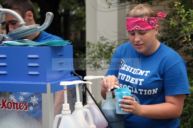R.S.A. hands out Sno-Kones to incoming freshman as they wait in line on South Campus in Lexington , Ky., on Friday, August 23, 2013. Photo by Eleanor Hasken | Staff