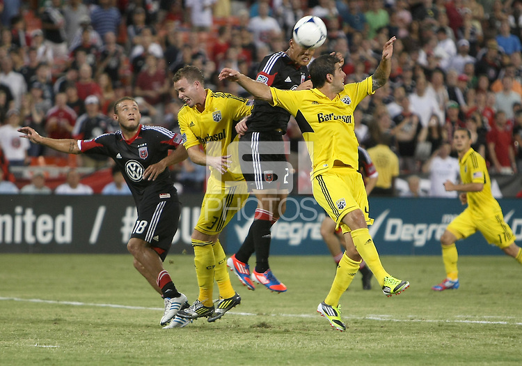 WASHINGTON, DC - AUGUST 4, 2012:  Long Tan (27) of DC United heads the ball behind Carlos Mendes (4) of the Columbus Crew during an MLS match at RFK Stadium in Washington DC on August 4. United won 1-0.