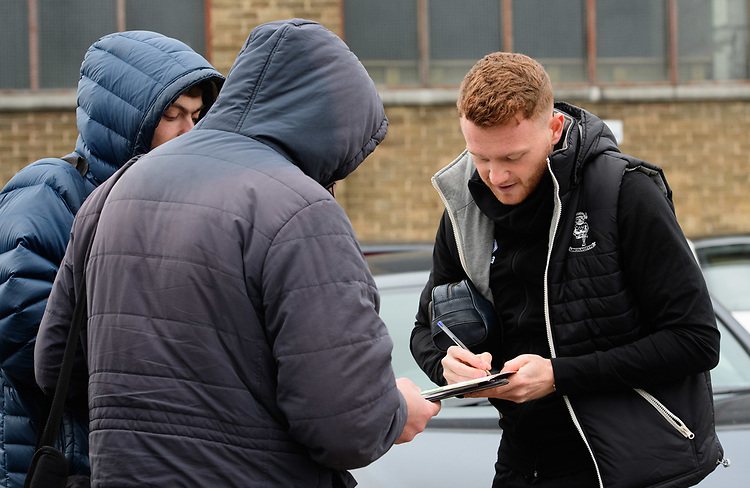 Lincoln City's James Brown signs autographs for fans after arriving at the ground<br /> <br /> Photographer Chris Vaughan/CameraSport<br /> <br /> The EFL Sky Bet League Two - Lincoln City v Grimsby Town - Saturday 19 January 2019 - Sincil Bank - Lincoln<br /> <br /> World Copyright &copy; 2019 CameraSport. All rights reserved. 43 Linden Ave. Countesthorpe. Leicester. England. LE8 5PG - Tel: +44 (0) 116 277 4147 - admin@camerasport.com - www.camerasport.com