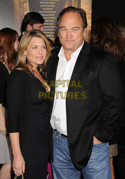 """Jennifer Sloan & Jim Belushi.The World Premiere of """"New Year's Eve' held at The Grauman's Chinese Theatre in Hollywood, California, USA..December 5th, 2011.half length black dress suit jacket white shirt married husband wife .CAP/ROT/TM.©Tony Michaels/Roth Stock/Capital Pictures"""