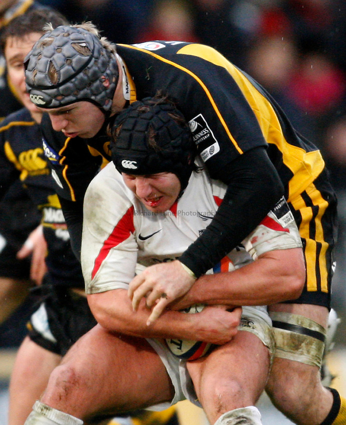 Photo: Richard Lane/Richard Lane Photography..London Wasps v Newcastle Falcons. EDF Energy Cup. 01/12/2007. .Wasps' James Haskell tackles Falcons' James Grindall.