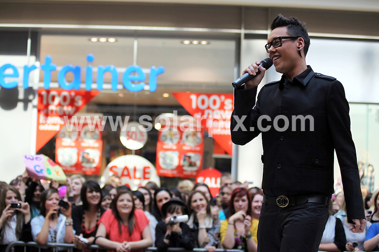 """**ALL ROUND PICTURES FROM SOLARPIX.COM**.**WORLDWIDE SYNDICATION RIGHTS**.Gok Wan recording the next series of Channel 4 Television's """"How to look good naked"""" series at the Bullring shopping centre in Birmngham, UK. 7 August 2009.This pic: Gok Wan..JOB REF: 9713 NYA     DATE: 07_08_2009.**ALL ROUND EXCLUSIVE PICTURES FROM SOLARPIX.COM"""