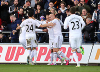 SWANSEA, WALES - FEBRUARY 21: Ki Sung Yueng of Swansea (C) celebrates his equaliser with team mates during the Barclays Premier League match between Swansea City and Manchester United at Liberty Stadium on February 21, 2015 in Swansea, Wales.