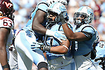 04 October 2014: UNC's Nazair Jones (90) celebrates his sack with teammates. The University of North Carolina Tar Heels hosted the Virginia Tech Hokies at Kenan Memorial Stadium in Chapel Hill, North Carolina in a 2014 NCAA Division I College Football game. Virginia Tech won the game 34-17.