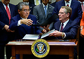 Ambassador Shinsuke Sugiyama, Ambassador of Japan to the United States, left, and US Trade Representative Robert Lighthizer, right, exchange documents as they sign the US-Japan Trade Agreement and US-Japan Digital Trade Agreement in the Roosevelt Room of the White House in Washington, DC on Monday, October 7, 2019.<br /> Credit: Ron Sachs / Pool via CNP