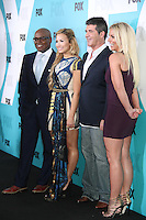 L.A. Reid, Demi Lovato, Simon Cowell and Britney Spears at the Fox 2012 Programming Presentation Post-Show Party at Wollman Rink in Central Park on May 14, 2012 in New York City.