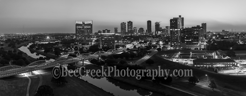 Another aerial panorama image in black and white of the Fort Worth skyline with the Seventh Street bridge as it crosses the Trinity River in downtown. The 7th street bridge was lighted up nicely so it really popped in this image of the cityscape in black and white. Fort Worth is the fifth largest city in Texas. Ft Worth is located in central north part of Texas and the county seat is Tarrant County. The latest census is that the population for Fort Worth is estimates, at around 854,113. The city is the second-largest in the Dallas–Fort Worth–Arlington metropolitan area or the DFW Metro.