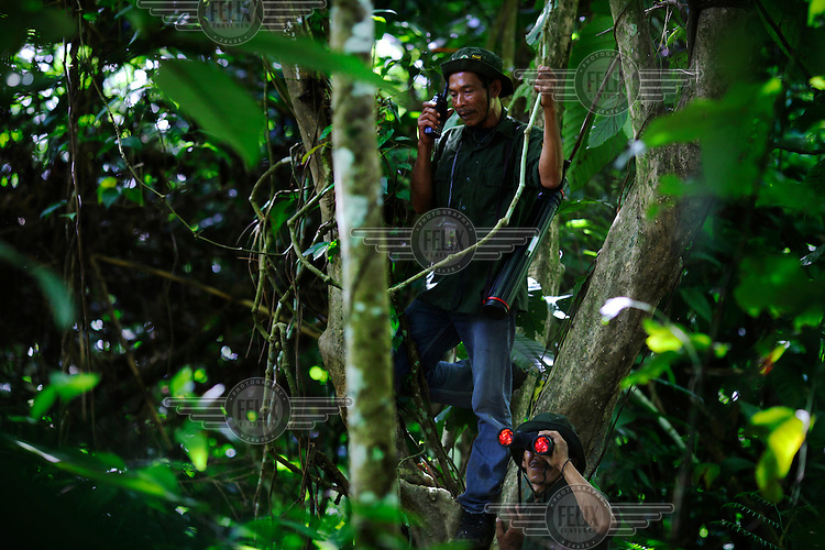44 year old Muktar (top) patrols the forest with a fellow ranger. He was an illegal logger in the Ulu Masen Forest for over 10 years before undergoing training by Fauna and Flora International (FFI, partially funded by the World Bank and the Multi Donor Fund) at a Conservation Response Unit (CRU) on the edge of the Forest. The CRU is responsible for training rangers and working to help community members understand how to best protect the forest whilst providing economic benefits and livelihood opportunities to local communities..