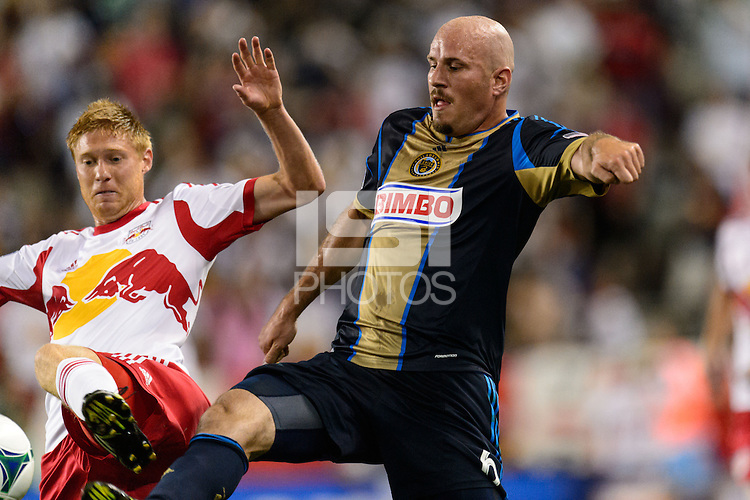 Conor Casey (6) of the Philadelphia Union and Markus Holgersson (5) of the New York Red Bulls. The New York Red Bulls and the Philadelphia Union played to a 0-0 tie during a Major League Soccer (MLS) match at Red Bull Arena in Harrison, NJ, on August 17, 2013.