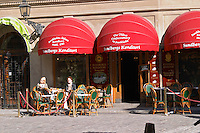 A cafe in the Old Town, Gamla Stan. Two women having coffee in the sun. Stockholm. Sweden, Europe.