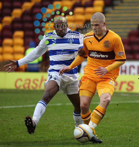 Fouad Bachirou can't stop Henrik Ojamaa. Saturday 4th February 2012 Motherwell v Greenock Morton in the William Hill Scottish Cup 5th round tie at Fir Park Stadium Motherwell. Universal News And Sport (Europe) All pictures must be credited to www.unpixs.com. (Office)0844 884 51 22.