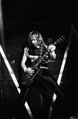 Iron Maiden - guitarist Adrian Smith - performing live on the Killer World Tour featuring new vocalist Bruce Dickinson at the Palasport in Bologna Italy - 26 Oct 1981.  Photo credit: PG Brunelli/IconicPix