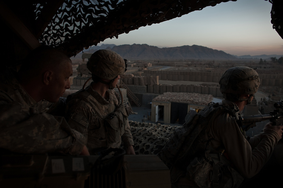 2nd Lt. Nathan Wagnon (left) and two of his troopers from Charlie Co. 1st Battalion 12th Infantry Regiment, 4th Infantry Division in Zhari District, Kandahar, Afghanistan look out across the Zandahari countryside after spotting and taking sporadic fire from Taliban fighters near a mosque several hundred meters outside their outpost perimeter.