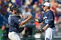 North Carolina catcher Brian Holberton (10) congratulates pitcher Chris McCue (17) after the game against the Louisiana State Tigers in the 2013 Men's College World Series on June 18, 2013 at TD Ameritrade Park in Omaha, Nebraska. The Tar Heels defeated the Tigers 4-2, eliminating LSU from the tournament. (Andrew Woolley/Four Seam Images)