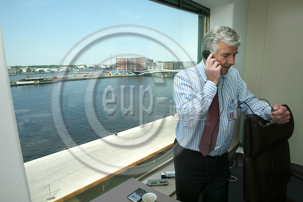 AMSTERDAM - BELGIUM - 04 JULY 2006 -- Anders MOBERG the CEO of Ahold, speaking in phone from his office at the Royal Ahold's Headquarters (HQ). PHOTO: ERIK LUNTANG / EUP-IMAGES