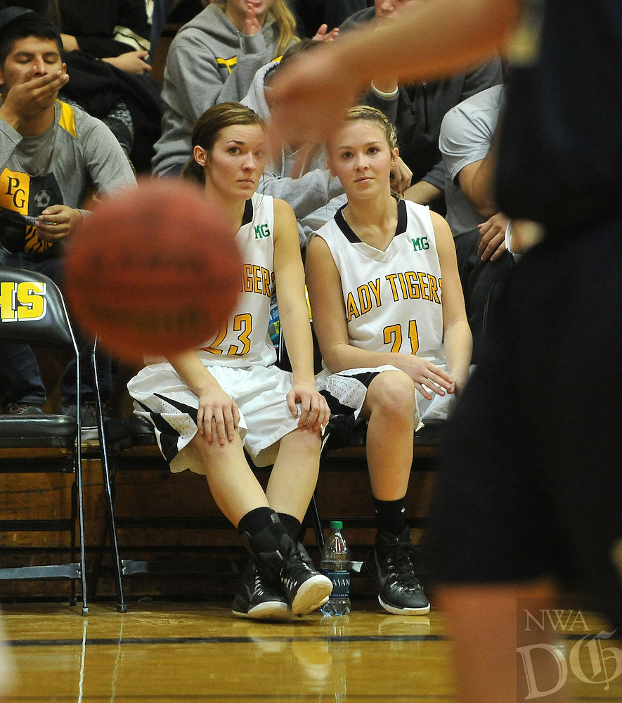 NWA Media/Michael Woods --01/06/2015-- w @NWAMICHAELW...Prairie Grove's Mattie Hartin (23) and Taylor Hartin (21) rest on the bench during Tuesday nights game against Shiloh Christian at Prairie Grove High school.