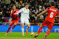 Real Madrid´s Gareth Bale and Sevilla's Timothee Kolodziejczak during 2014-15 La Liga match between Real Madrid and Sevilla at Santiago Bernabeu stadium in Alcorcon, Madrid, Spain. February 04, 2015. (ALTERPHOTOS/Luis Fernandez) /NORTEphoto.com