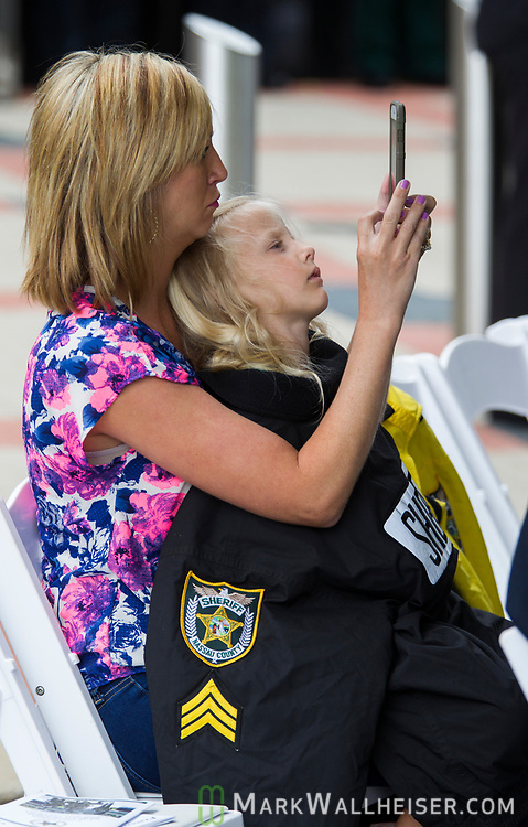 Brandi Crews and her 5 year old daughter Alaina take a photo during the Florida Sheriffs Association 2017 Law Enforcement Memorial Ceremony at the Florida Sheriffs Association in Tallahassee, Florida.