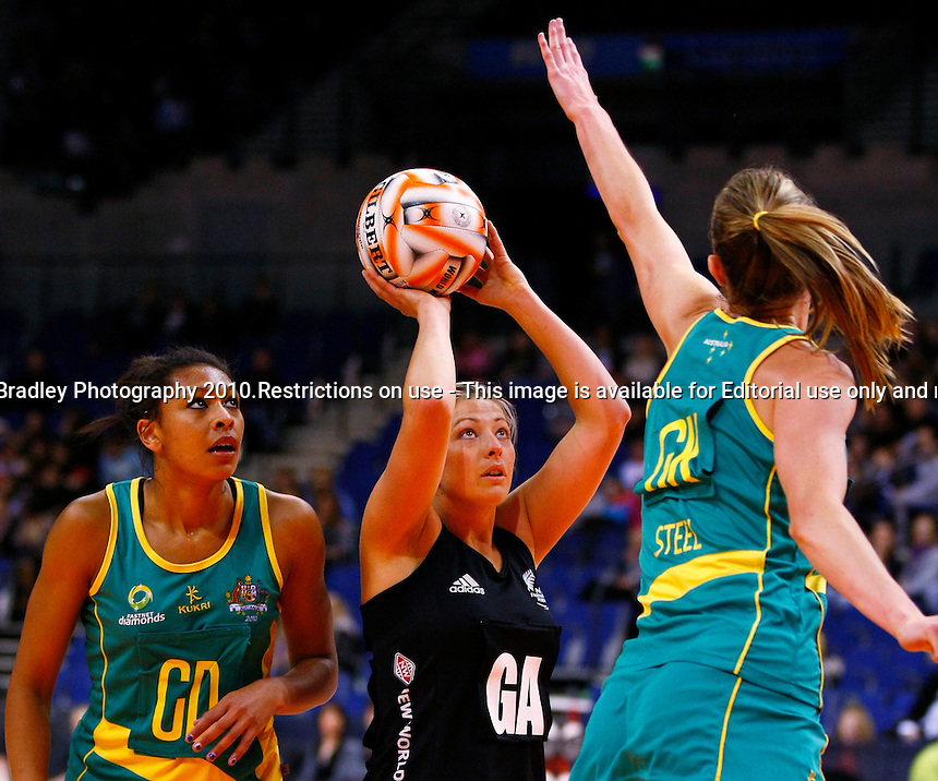 19.11.2010 The Silver Ferns' Anna Thompson, centre, puts up a shot against Australia during their match in the World Netball Series in Liverpool, England. Mandatory Photo Credit (Pic: Tim Hales). ©Michael Bradley Photography.