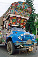 A lorry decorated with paintings and symbols in Islamabad, Pakistan