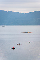 Fishing boats on Lake Toba (Danau Toba) at sunrise, North Sumatra, Indonesia