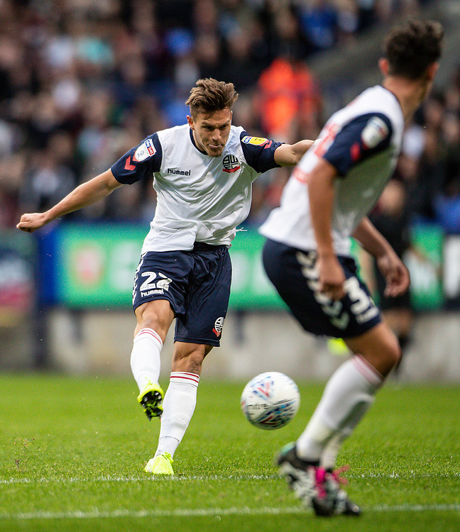 Bolton Wanderers' Dennis Politic scoring his side's first goal <br /> <br /> Photographer Andrew Kearns/CameraSport<br /> <br /> EFL Leasing.com Trophy - Northern Section - Group F - Bolton Wanderers v Bradford City -  Tuesday 3rd September 2019 - University of Bolton Stadium - Bolton<br />  <br /> World Copyright © 2018 CameraSport. All rights reserved. 43 Linden Ave. Countesthorpe. Leicester. England. LE8 5PG - Tel: +44 (0) 116 277 4147 - admin@camerasport.com - www.camerasport.com