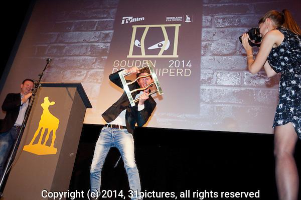 Nederland, Utrecht, 01 oktober 2014. Het 34ste Nederlands Film Festival 2014. Tygo Gernandt wint Gouden Gluiperd 2014 voor beste film boef in Bloedlink, uitgereikt door TV Film Magazine. Foto: 31pictures.nl / The Netherlands, Utrecht, 01 October 2014. The 34rd Netherlands Film Festival 2014. Tygo Gernandt wins Gouden Gluiperd for Best Film Villain in Bloedlink, Award by TV Film Magazine. Photo: 31pictures.nl / (c) 2014, www.31pictures.nl