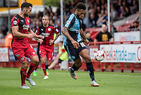 Aaron Holloway of Wycombe Wanderers with the ball being closely watched by Jon Ashton of Crawley Town during the Sky Bet League 2 match between Crawley Town and Wycombe Wanderers at Checkatrade.com Stadium, Crawley, England on 29 August 2015. Photo by Liam McAvoy.