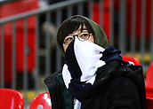 30th January 2019, Wembley Stadium, London England; EPL Premier League football, Tottenham Hotspur versus Watford; A South Korean Tottenham Hotspur fan wrapped up warm in the cold conditions
