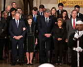 Members of the Bush family bow their heads in prayer in the Rotunda of the US Capitol during the ceremony honoring the former United States President George H.W. Bush, who will Lie in State in the Rotunda of the US Capitol on Monday, December 3, 2018. From left to right: former United States President George W. Bush, former first lady Laura Bush, former Governor Jeb Bush (Republican of Florida), Columba Bush, and Neil Bush.<br /> Credit: Ron Sachs / CNP<br /> (RESTRICTION: NO New York or New Jersey Newspapers or newspapers within a 75 mile radius of New York City)