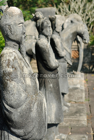 Asia, Vietnam, Hue. Statues in the palace forecourt of the royal tomb of Dong Khanh. Designated a UNESCO World Heritage Site in 1993, Hue is honoured for its complex of historic monuments. Seven royal tombs are scattered across the scenic countryside to the south of Hue. The smallest of all Nguyen tombs is the well-preserved mausoleum of Dong Khanh.