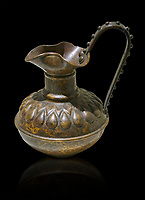 Phrygian bronze trefoil jug with a beated geometric design. From Gordion. Phrygian Collection, 8th century BC - Museum of Anatolian Civilisations Ankara. Turkey. Against a black background