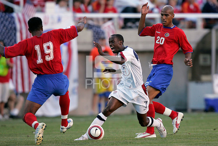 USA's DaMarcus Beasley gets double teamed by Costa Rica's Mauricio Wright and Douglas Sequeira. U.S.A. defeated Costa Rica 3 - 0 in final round World Cup qualifying at Rice-Eccles Stadium, Salt Lake City, UT, on June 4, 2005. Sequeira was red carded late in the game and will have to sit out the next qualifier.