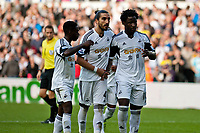 Saturday 19 October 2013 Pictured: Nathan Dyer, Chico Flores and Wilfried Bony celebrate the penalty<br /> Re: Barclays Premier League Swansea City vSunderland at the Liberty Stadium, Swansea, Wales