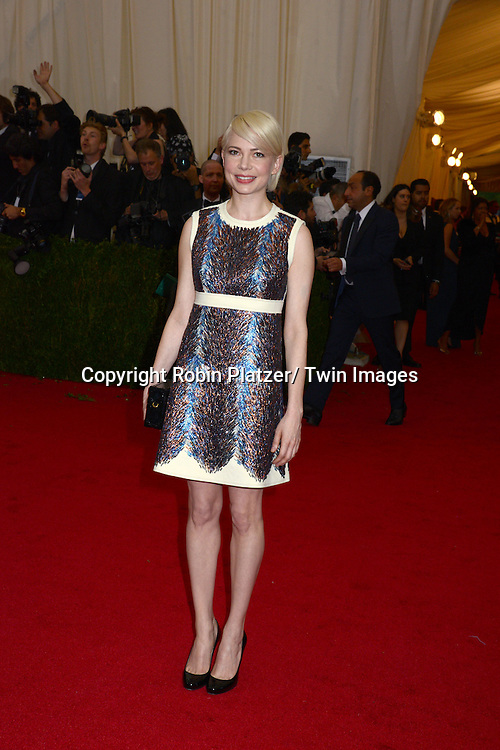 Michelle Williams attends the Costume Institute Benefit on May 5, 2014 at the Metropolitan Museum of Art in New York City, NY, USA. The gala celebrated the opening of Charles James: Beyond Fashion and the new Anna Wintour Costume Center.