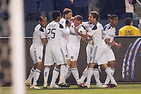LA Galaxy forward Chad Barrett (11) celebrates his goal with teammate. The LA Galaxy defeated the Portland Timbers 3-0 at Home Depot Center stadium in Carson, California on  April  23, 2011....