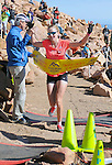 August 15, 2015 - Manitou Springs, Colorado, U.S. - Eagle, Colorado runner, Kim Dobson, crosses the finish line to win the women's race in the Pikes Peak Ascent during the 60th running of the Pikes Peak Ascent and Marathon.  During the Ascent, runners cover 13.3 miles and gain more than 7815 feet (2382m) by the time they reach the 14,115ft (4302m) summit.  On the second day of race weekend, 800 marathoners will make the round trip and cover 26.6 miles of high altitude and very difficult terrain in Pike National Forest, Manitou Springs, CO.
