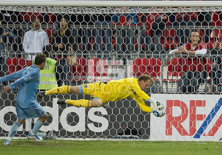 Sporting KC goalkeeper Eric Kronberg #18 makes a save during an MLS game between Sporting Kansas City and the Toronto FC at BMO Field in Toronto on June 4, 2011..The game ended in a 0-0 draw...