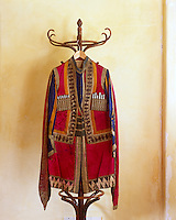 """The gilt embroidery on this jacket designed for the Ballet """"Thamar"""" in 1912 may be faded but its bold diamond pattern and orange, yellow and blue panelling is still bold"""