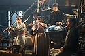 London, UK. 25.04.2014. VENICE PRESERV'D, a site responsive production, by the Spectators' Guild, opens at Payne & Borthwick Wharf. Picture shows: Ceridwen Smith (flute), Julian Harries (Accordion), Sufia Manya (Oboe), Zoot Lynam (Hand Pan) and Miguel H Torres Umba (Arlequino/Theodore). Photograph © Jane Hobson.