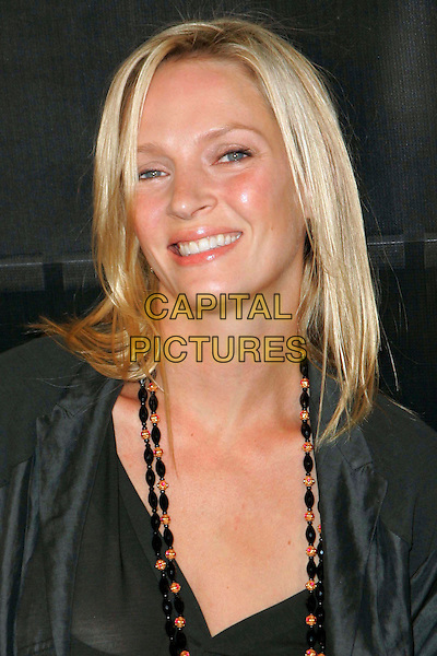 "UMA THURMAN.At Donna Karan ""Gold"" Fragrance Collection Launch Party at Donna Karan Flagship Store, New York, New York, USA..October 12th, 2006.Ref: ADM/JL.headshot portrait .www.capitalpictures.com.sales@capitalpictures.com.©Jackson Lee/AdMedia/Capital Pictures."