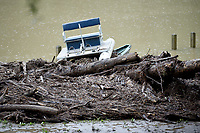 NWA Democrat-Gazette/DAVID GOTTSCHALK Floating debris, a damaged dock and a displaced boat are visible Friday, June 7, 2019, following heavy rains that caused flash flooding on Lee Creek that runs through Devil's Den State Park. Flash flooding Thursday night closed two state highways in Washington County along with a number of county roads. No injuries had been reported by this morning.