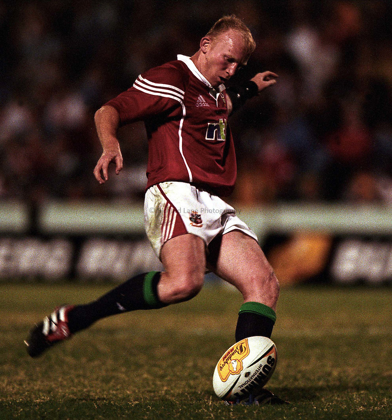 Photo. Richard Lane. .Lions Tour 2001 to Australia. Match 2. Lions v Queensland President's XV at the Dairy Farmer Stadium, Townsville, Queensland, Australia. 12/6/2001.Neil Jenkins attempts another kick.